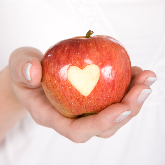 apple with heart carved into it